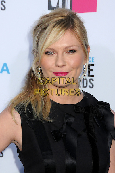 Kirsten Dunst.17th Annual Critics Choice Movie Awards - Arrivals held at the Hollywood Palladium,  Los Angeles, California, USA, 12th January 2012..arrivals portrait headshot  black  pink lipstick side ponytail hair make-up beauty ribbons silk satin .CAP/ADM/BP.©Byron Purvis/AdMedia/Capital Pictures.