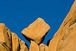 Eroded rock boulder balanced in wedge on outcrop near Barker Dam, Joshua Tree National Park, California