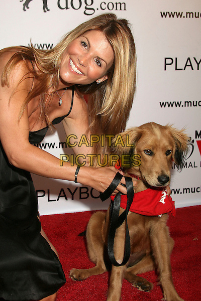 """LORI LOUGHLIN.Much Love Animal Rescue's """"Bow Wow Wow"""" Benefit at the Playboy Mansion, Beverly Hills, California , USA, .14 July 2007..half length dog pet animal.CAP/ADM/BP.©Byron Purvis/AdMedia/Capital Pictures."""