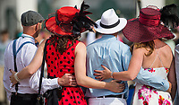 LOUISVILLE, KY - MAY 04: Racegoers pose for a group photo on Kentucky Oaks Day at Churchill Downs on May 4, 2018 in Louisville, Kentucky. (Photo by Eric Patterson/Eclipse Sportswire/Getty Images)