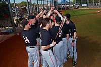 Ball State Cardinals team huddle before a game against the Saint Joseph's Hawks on March 9, 2019 at North Charlotte Regional Park in Port Charlotte, Florida.  Ball State defeated Saint Joseph's 7-5.  (Mike Janes/Four Seam Images)