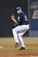 Asheville Tourists pitcher Troy Neiman #23 delivers a pitch during opening night game against the Delmarva Shorebirds at McCormick Field on April 3, 2014 in Asheville, North Carolina. The Tourists defeated the Shorebirds 8-3. (Tony Farlow/Four Seam Images)