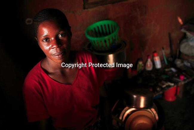 Nyota Vumiliya, age 27,, in her small room in Dubie, Katanga, Congo, DRC. Photo: Per-Anders Pettersson
