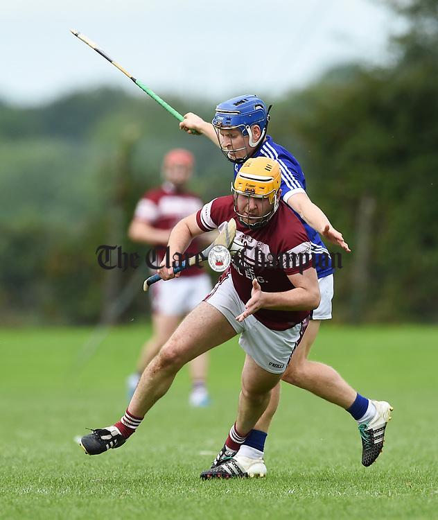Podge Collins of Cratloe in action against Leo Duggan of St Joseph's Doora Barefield during their round three senior championship game in Sixmilebridge. Photograph by John Kelly