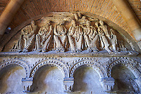 "Early Anglo Saxon sulptures of Christ and the  Apostles now part of the south porch of Malmesbury Abbey, Wiltshire, England. The apostles, apart from Peter who holds a crude key, have no distinguishing feature to allow identification. Some are holding books, none have halos and some hold their heads at awkward angles. These three styles are typical of Anglo Saxon art. The two panels are 10 ft long and 4ft 6"" high are date from the original Ango Saxon church of 705. They were probablbly built into the proch during the Norman rebuilding. The style of these sculptures is of the Roman Byzantine style and were probably sculpted by masions from Gaul.  Malmesbury Abbey, Wiltshire, England"