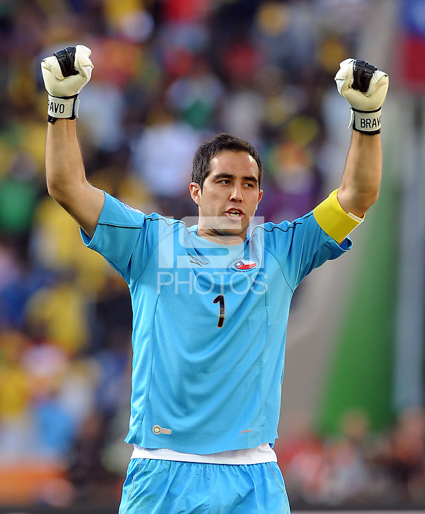 Claudio Bravo of Chile celebrates his side's opening goal