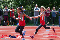 Kirkwood's Andrea Kuehnlein hands off the baton to Jordan Roundtree on their way to victory in the 4x200 relay at the 2016 MSHSAA Class 5 District 2 Track and Field Meet at Ladue High School, St. Louis, Saturday, May 14.