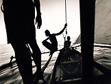 MADAGASCAR, Anjajavy, fisherman in pirogue sailing back to their village at the end of the day