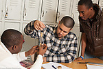 Education High School science class  male students working together on experiment