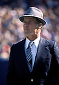 Dallas Cowboys Tom Landry head coach during a game from the 1978 season . Tom Landry coach for 29 years all with the Dallas Cowboys and was inducted to the Pro Football Hall of Fame in 1990.