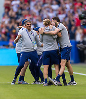 LYON,  - JULY 7: Jill Ellis celebrates with Tony Gustavsson during a game between Netherlands and USWNT at Stade de Lyon on July 7, 2019 in Lyon, France.