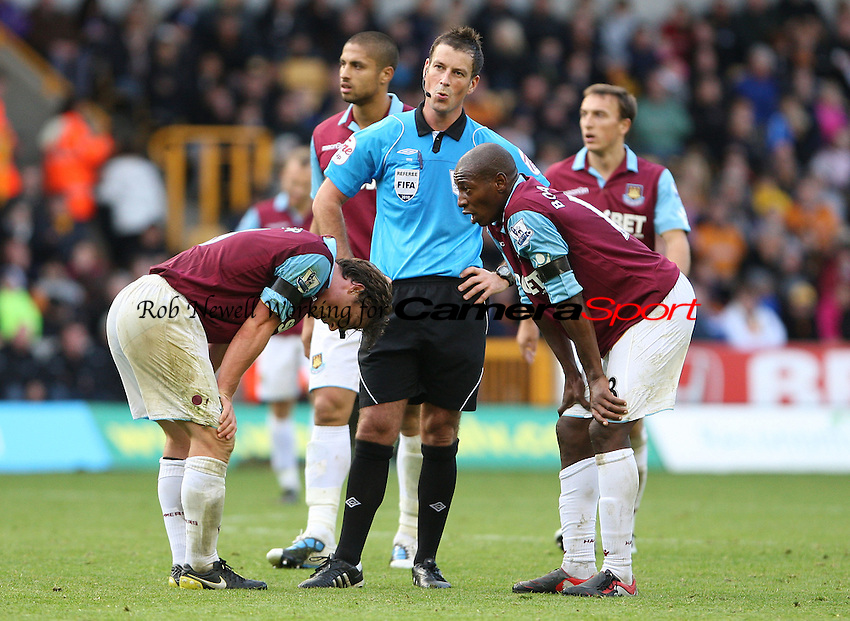 West Ham players surround referee Mark Clattenburg - Wolverhampton Wanderers vs West Ham United, Barclays Premier League at Molineaux, Wolverhampton - 16/10/10 - MANDATORY CREDIT: Rob Newell/TGSPHOTO - Self billing applies where appropriate - 0845 094 6026 - contact@tgsphoto.co.uk - NO UNPAID USE.