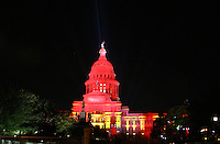 Texas State Capitol floodlit in Red, Austin, Texas, USA