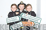 CROSSROADS: Which road do I take says Sorcha,Cillian and Caoimhe Kennelly (Ballylongford) as they marched in the Ballylongford Oyster Festival Fancy Dress Parade on Friday......