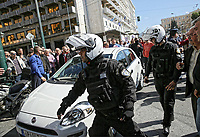 "Pictured: Police help an Uber cab pass through as taxi drivers attack it in Syntagma Square, Athens Greece. Tuesday 06 March 2018<br /> Re: Taxi drivers have attacked Uber vehicles while protesting against Uber operating in Athens, Greece.<br /> Taxi drivers will on strike for nine hours on Tuesday8 a.m. to 5 p.m. in protest at what they call unfair competition from Uber taxi services.<br /> In a statement, the SATA union representing cab drivers in Attica also expressed dismay at delays in passing a Transport Ministry bill to reorganize their sector and derided ""innovative platforms that rob taxi drivers and the country."""