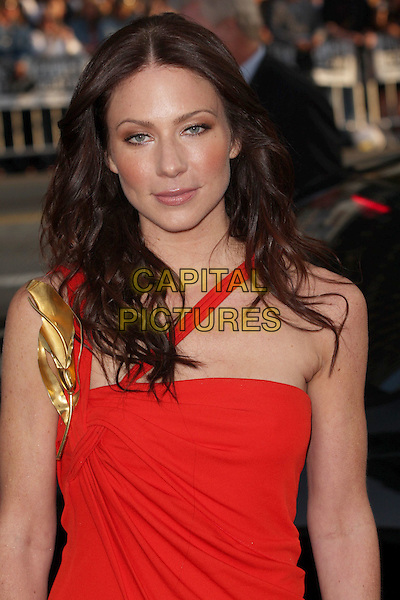 "LYNN COLLINS.""X-Men Origins: Wolverine"" Los Angeles Industry Screening held at Grauman's Chinese Theatre, Hollywood, CA, USA. .April 28th, 2009 .half length red gold one shoulder .CAP/ADM/CH.©Charles Harris/AdMedia/Capital Pictures"