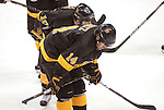 March 26,  2011                      Colorado left wing Stephen Schultz (14) and Colorado defenseman Gabe Guentzel (A) (10, behind him) hang their heads after their loss. The University of Michigan defeated Colorado College 2-1 in the championship game of the NCAA Division 1 Men's West Regional Hockey Tournament, on Saturday March 26, 2011 at the Scottrade Center in downtown St. Louis.