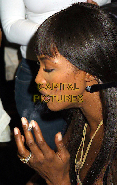 NAOMI CAMPBELL..Backstage at the Anna Sui Fashion Show. ..Ref: IW..fringe, profile, smoking, cigarette, headshot, portrait..www.capitalpictures.com..sales@capitalpictures.com..©Capital Pictures