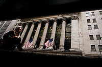A woman walks in front New York Stock Exchange while Verizon Management discusses Q4 2011 results in New York, United States. 23/01/2012.  Photo by Eduardo Munoz Alvarez / VIEWpress.
