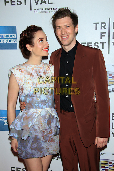 "Zoe Lister-Jones and Daryl Wein.The 2012 Tribeca Film Festival World Premiere of ""Lola Versus"" at the Tribeca Performing Arts Center, New York, NY, USA..April 24th, 2012.half length dress peplum blue white profile looking up beige print black shirt brown suit.CAP/LNC/TOM.©LNC/Capital Pictures."