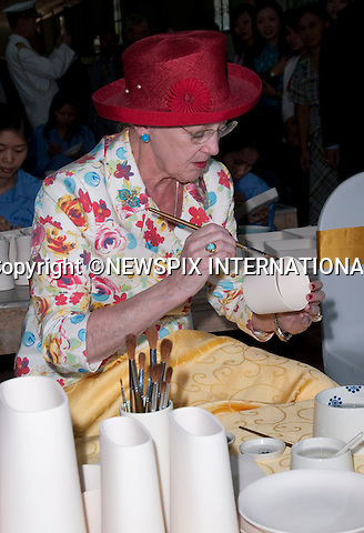 """CROWN PRINCESS MARY AND QUEEN MARGRETHE.Queen Margrethe should that she is a deft hand at painting while visiting Phomex a Ceramics Factory in Ba Trang, Hanoi. The Queen painted several ceramics pieces named after her grandchildren. Not to be out done Crown Princess Mary painted a ceramic plate and vase_3/11/2009.Mandatory Photo Credit: ©Dias/Newspix International..**ALL FEES PAYABLE TO: """"NEWSPIX INTERNATIONAL""""**..PHOTO CREDIT MANDATORY!!: NEWSPIX INTERNATIONAL(Failure to credit will incur a surcharge of 100% of reproduction fees)..IMMEDIATE CONFIRMATION OF USAGE REQUIRED:.Newspix International, 31 Chinnery Hill, Bishop's Stortford, ENGLAND CM23 3PS.Tel:+441279 324672  ; Fax: +441279656877.Mobile:  0777568 1153.e-mail: info@newspixinternational.co.uk"""