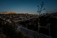 The separation barrier surrounds the Shuafat camp in the West bank at on June 11, 2016. <br /> Photo Daniel Berehulak for the New York Times