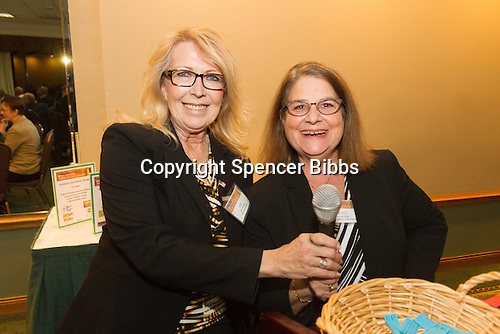 The Hyde Park Chamber of Commerce held its 96th Annual Anniversary Dinner Thursday evening at the LaQuinta Inn and Suites located at 4900 S. Lake Shore Drive.<br /> <br /> 7639 &ndash; M.C.&rsquo;s for the evening, Vice President and General Manager of the Hyde Park Herald News Paper, Susan J. Walker and Jayce Feuer of Joyce&rsquo;s Events and Party Planning<br /> <br /> Please 'Like' &quot;Spencer Bibbs Photography&quot; on Facebook.<br /> <br /> All rights to this photo are owned by Spencer Bibbs of Spencer Bibbs Photography and may only be used in any way shape or form, whole or in part with written permission by the owner of the photo, Spencer Bibbs.<br /> <br /> For all of your photography needs, please contact Spencer Bibbs at 773-895-4744. I can also be reached in the following ways:<br /> <br /> Website &ndash; www.spbdigitalconcepts.photoshelter.com<br /> <br /> Text - Text &ldquo;Spencer Bibbs&rdquo; to 72727<br /> <br /> Email &ndash; spencerbibbsphotography@yahoo.com