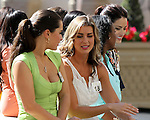 Ms Racing Queen contestants in the walking ring between races at Gulfstream Park,  Hallandale Beach, Florida 03-01-2014