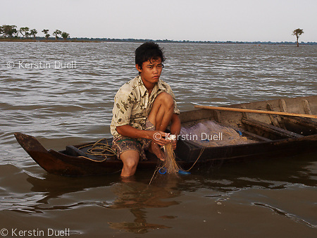 Floating Lives on the Tonle Sap - Villagers depend on fishing for income and as the main food source. Using controversial fishing techniques, fishermen are afraid of environmentalists and state agents and avoid being photographed.