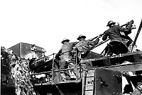 14-inch gun talks for U.S. Men of the 35th Coast Artillery loading a mobile railroad gun, 13.9 inches calibre, on the Argonne front.  Baleycourt, France.  September 26, 1918. Lt. Richard W. Sears. (Army)<br /> NARA FILE #:  111-SC-23134<br /> WAR & CONFLICT BOOK #:  625
