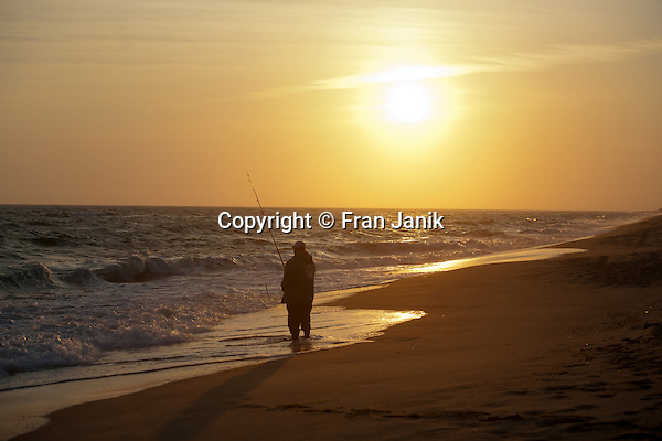 Man surfcasting on South beach in Edgartown MA.