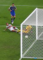 Mario Goetze of Germany scores a goal past Argentina goalkeeper Sergio Romero to make the score 1-0