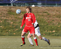 St. Lawrence forward Morgan Smith (15) collects a pass.  NCAA Division III Sectionals. In double-overtime, Amherst College (white) defeated St. Lawrence University (red), 2-1, on Hitchcock Field at Amherst College on November 23, 2013.