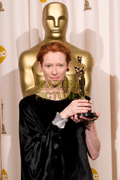 TILDA SWINTON.Best Supporting Actress winner Tilda Swinton backstage during the 80th Annual Academy Awards at the Kodak Theatre in Hollywood, California, USA..February 24th, 2008.oscars half length black dress diamond bracelet award trophy winner .CAP/A.M.P.A.S./AW.Supplied by AW/A.M.P.A.S./Capital Pictures.