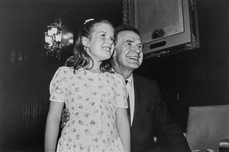 Ashley (age 7.5) and father Sen. Donald W. Riegle, D-Mich., watch video of gymnast Shannon Miller in Capitol Hill on Aug. 6, 1992. (Photo by Laura Patterson/CQ Roll Call)