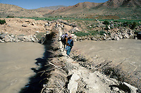 A farmer on is hors crossing the Harï Rüd river on a locale bridge, on the road to the Menar e Jam in the Ghor province - Afghanistan..From western Afghan capital Herat to the former capital of the Ghorides Empire Fîrûzkôh, next to the Menar e Jam..-The full text reportage is available on request in Word format