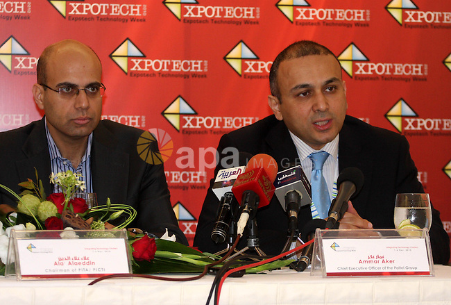 The chief executive officer of the paltel group, Ammar Aker (R) and the chairman of Pita/picti, Alaa Alaeddin (L), during their joint press conference in the West Bank town of Ramallah,  Monday, Nov. 1, 2010. Photo by Issam Rimawi