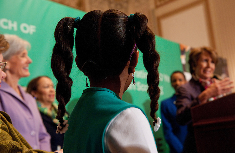 UNITED STATES - FEBRUARY 01:  A Scout looks on as House Minority Leader Nancy Pelosi, D-Calif., speaks during a celebration of the Girl Scouts' 100th birthday in Cannon Caucus Room.  HHS Secretary Kathleen Sebelius, left, and other Congressional leaders also attended.  (Photo By Tom Williams/CQ Roll Call)