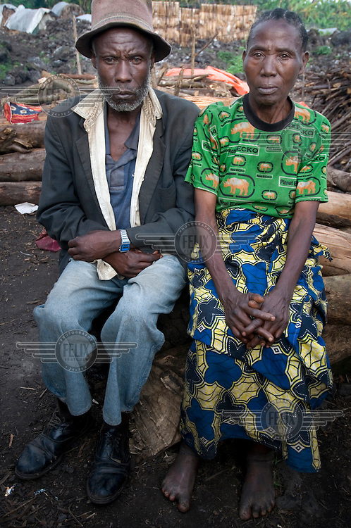 62 year old Anyesi Mukangusi and her 60 year old husband Gahiye sit at the Mugunga I IDP (Internally Displaced Persons) camp. They have lost six of their 11 children in the recent conflict. Anyesi is still in shock. She sits shaking, having not eaten anything for days.