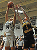 Grace Zagaja #14 of Harborfields, left, grabs a rebound as Sophie Triandafils #1 of Shoreham-Wading goes up alongside her during the Suffolk County varsity girls basketball Class A semifinals at Harborfields High School in Greenlawn, NY on Tuesday, Feb. 21, 2017. Zagaja recorded 10 points and 23 boards in Harborfields' win.