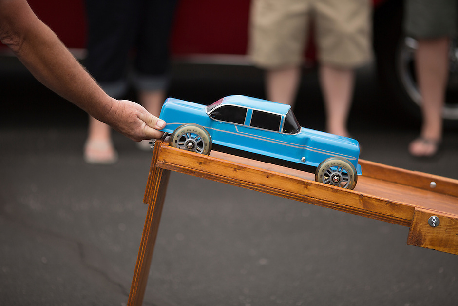 A participant readies his car during valve cover racing at the 4th State Representative Chevy Show on Saturday, July 2, 2016, in Fort Wayne, Indiana. (Photo by James Brosher)