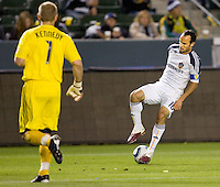 LA Galaxy forward Landon Donovan moves with the ball as Chivas USA goalkeeper Dan Kennedy defends. The LA Galaxy defeated Chivas USA 2-0 during the Super Clasico at Home Depot Center stadium in Carson, California Thursday evening April 1, 2010.  .
