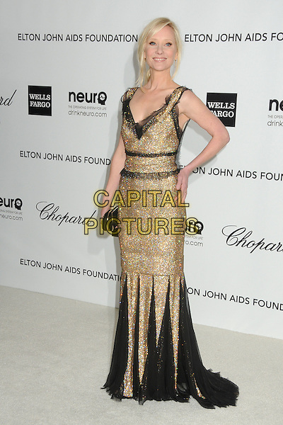Anne Heche.20th Annual Elton John Academy Awards Viewing Party held at West Hollywood Park, West Hollywood, California, USA..February 26th, 2012.full length black gold dress lace beads beaded clutch bag hand on hip oscars.CAP/ADM/BP.©Byron Purvis/AdMedia/Capital Pictures.