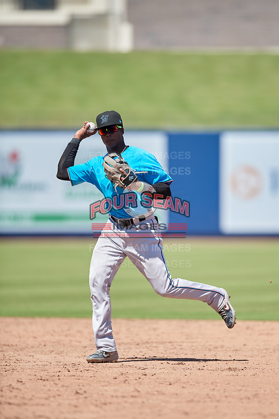 Miami Marlins second baseman Dalvy Rosario (98) throws to first base during an Instructional League game against the Washington Nationals on September 26, 2019 at FITTEAM Ballpark of The Palm Beaches in Palm Beach, Florida.  (Mike Janes/Four Seam Images)