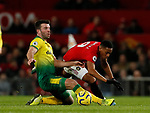 Grant Hanley of Norwich City tAnthony Martial of Manchester United ackles during the Premier League match at Old Trafford, Manchester. Picture date: 11th January 2020. Picture credit should read: James Wilson/Sportimage