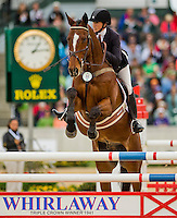 IRISH DIAMONDS, ridden by Micheline Jordan (CAN), competes during Stadium Jumping at the Rolex 3-Day Event at the Kentucky Horse Park in Lexington, Kentucky on April 28, 2013.