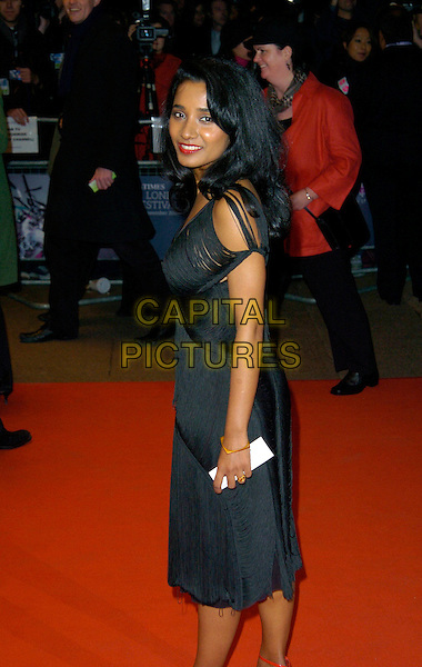 "TANNISHTHA CHATTERJEE.BFI London Film Festival UK Film Premiere of ""Brick Lane"" Odeon West End, London, England, .October 26th 2007..half length black dress 3/4 back over shoulder.CAP/CAN.©Can Nguyen/Capital Pictures"