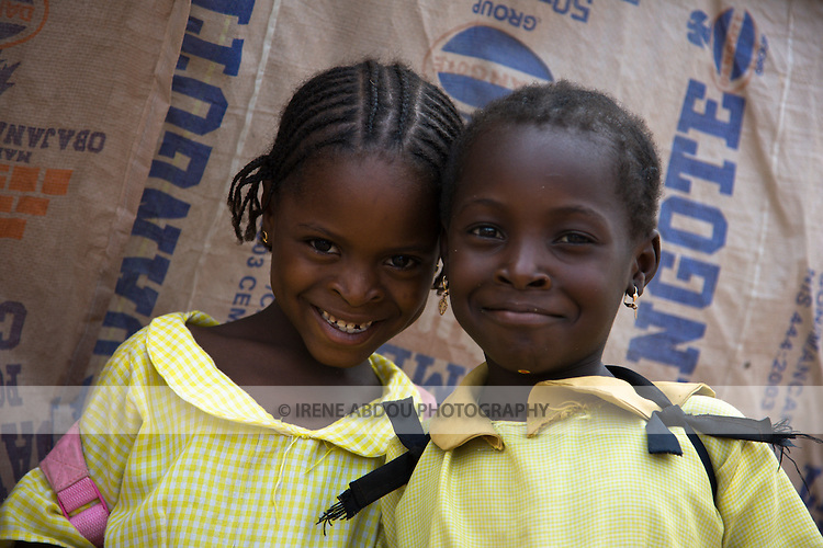 Students returning home from school pass through the Durumi market area of Abuja, Nigeria.