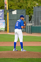 Ogden Raptors starting pitcher Jairo Pacheco (11) looks for the sign against the Idaho Falls Chukars in Pioneer League action at Lindquist Field on August 26, 2015 in Ogden, Utah. Ogden defeated the Chukars 5-1.  (Stephen Smith/Four Seam Images)