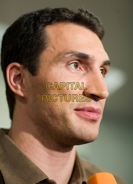 Wladimir Klitschko.Press conference in the newspaper the Moscow member of the Komsomol, Russia..November 23rd, 2006.headshot portrait brown shirt profile .CAP/PER/AM.©AM/PersonaStars/CapitalPictures